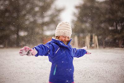 Happy girl enjoying snow - p1166m1176219 by Cavan Images