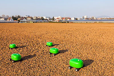 Five agricultural robots on a field - p300m1469675 by Werner Dieterich