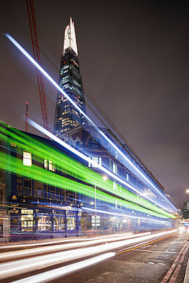 UK, England, London, Illuminated Shard skyscraper with light trails in foreground - p352m1126840f by Gustaf Emanuelsson