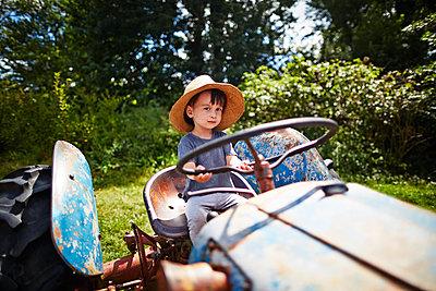 Boy on tractor - p584m1004610 by ballyscanlon
