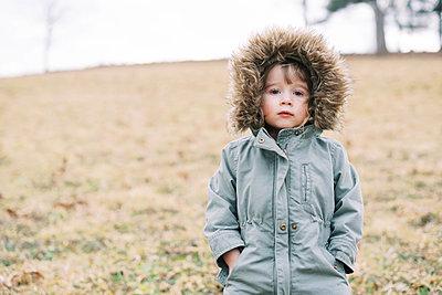 Two kids walking through a mowed meadow in winter. - p1166m2159504 by Cavan Images