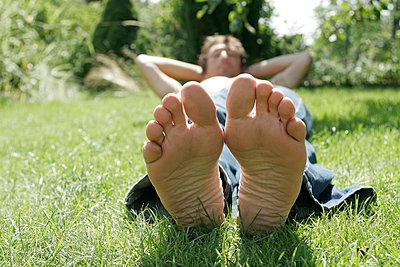 Lying barefoot in the grass - p1650488 by Andrea Schoenrock