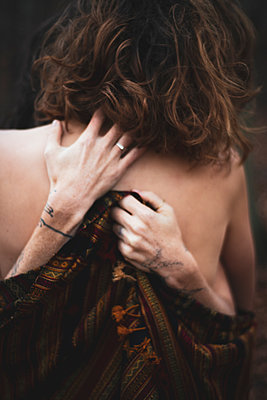 soft romantic hand detail of two gay women embracing in forrest - p1166m2177111 by Cavan Images