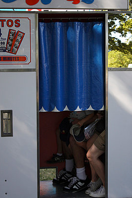 People sitting in a photobooth - p5780050 by Genie C Balantac