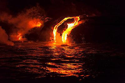 Lava flow into sea at night, Kilauea volcano, Hawaii - p924m805862f by Stuart Westmorland