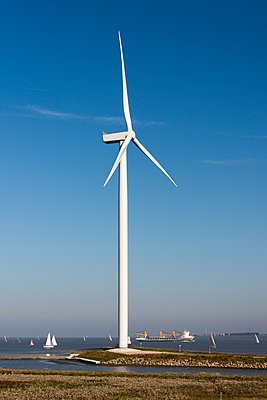 Wind turbine on the waterfront - p1079m1137123 by Ulrich Mertens