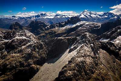 Impressive mountain scenery Fiordland Alps - p1154m1425713 by Tom Hogan