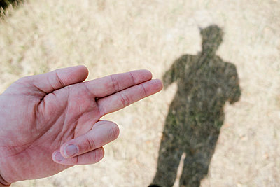 Hand and silhouette of person - p586m1110036 by Kniel Synnatzschke