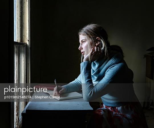 Girl writing a diary - p1019m2148274 by Stephen Carroll