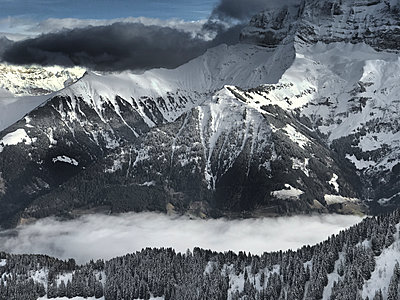 Snow in the mountains - p1048m2016567 by Mark Wagner