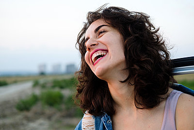 Portrait of a laughing young woman - p1363m2175822 by Valery Skurydin