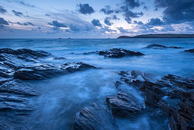 Twilight over Trevose Head from the rocky shores of Treyarnon Point - p871m861635 by Adam Burton