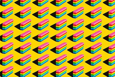 Pattern of rainbow colored erasers against yellow background - p300m2199666 by Xavier Lorenzo