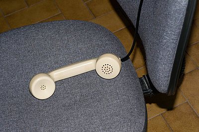 Telephone receiver on chair - p564m734977 by Dona