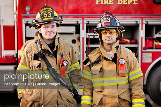 Two Firefighters Smiling in Front of Fire Engine