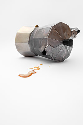 Knocked over espresso coffee pot - p1228m1538998 by Benjamin Harte