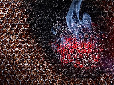 Burning cigarettes - p851m1148651 by Lohfink