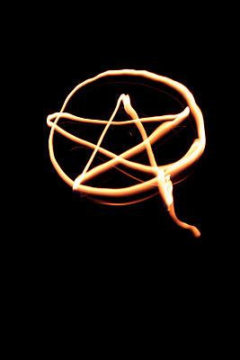 Burning pentagram - p1028m1044759 by Jean Marmeisse