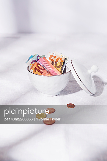 Saving money in a sugar bowl - p1149m2263056 by Yvonne Röder