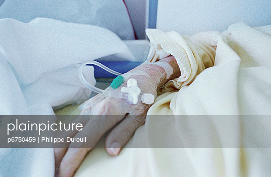 Elderly person with IV in arm - p6750459 by Philippe  Dureuil
