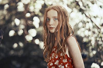 Portrait serious girl in park - p1023m2088084 by Arman Zhenikeyev