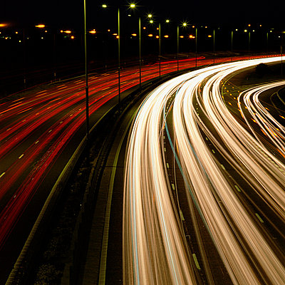 Head and tail-lights on motorway - p92410882f by Image Source