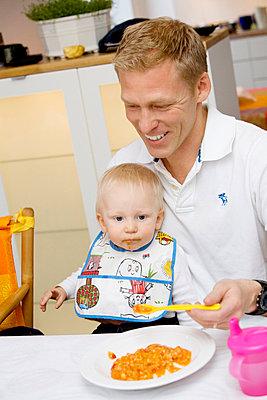A father feeding his baby Sweden. - p31221624f by Juliana Wiklund