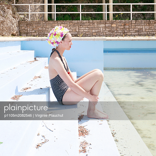 Woman by open air pool - p1105m2082546 by Virginie Plauchut