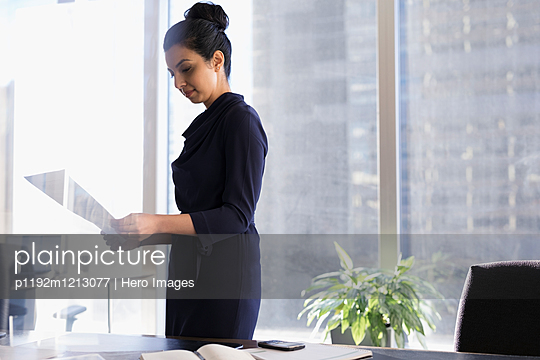 Female lawyer reviewing paperwork in urban office