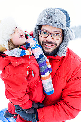 Father and daughter in winter clothing - p31227234f by Jakob Fridholm