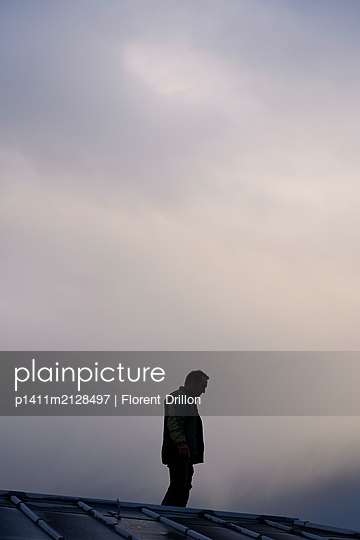 Man on the roof - p1411m2128497 by Florent Drillon