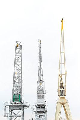 Three dockside cranes - p587m1155082 by Spitta + Hellwig
