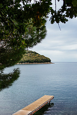 Wooden pier in the bay of Vrsar - p728m2027254 by Peter Nitsch