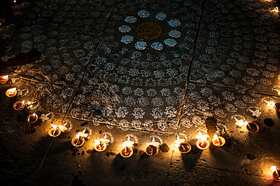 Candle light around Diwali rangoli - p1007m1144419 by Tilby Vattard