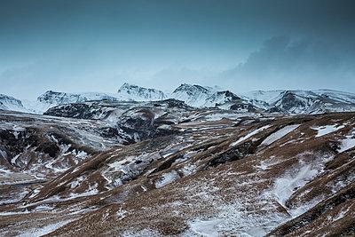 Snowy remote mountain range, Iceland - p1023m1086247f by David Henderson