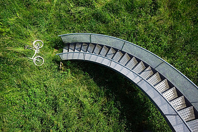 Bicycle in grass under spiral staircase - p42918747 by Mischa Keijser