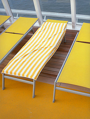 Cruise ship with yellow sunlounger - p4470346 by Anja Lubitz