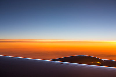 Setting sun seen from airplane - p1057m1466873 by Stephen Shepherd