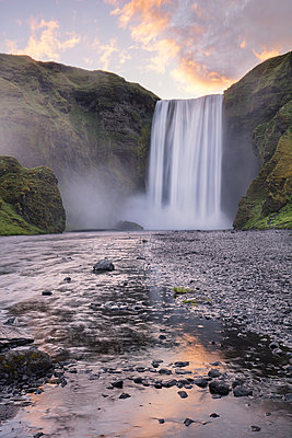 Skogafoss at sunrise in the summer, Iceland, Polar Regions - p871m2058022 by James Kerwin