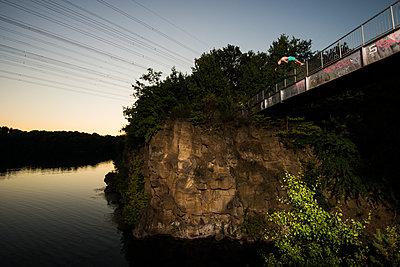 Cliff diver on bridge - p1142m1220743 by Runar Lind