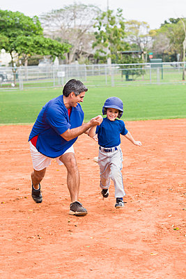 Hispanic coach and young baseball player - p555m1478686 by Kevin Dodge