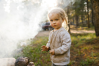Portrait of girl (2-3) roasting marshmallow over campfire, Wasatch Cache National Forest - p1427m2213544 by Jessica Peterson