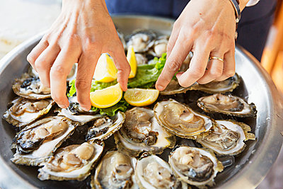 Eating oysters, close-up - p312m1472000 by Susanne Kronholm