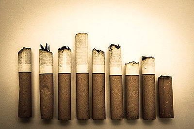 Row of cigarettes consumed. - p813m1039475 by B.Jaubert