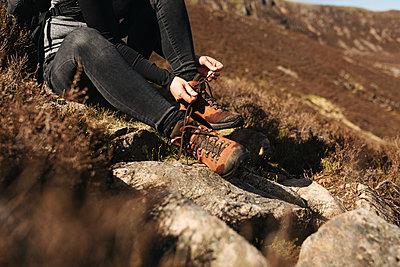 Tying shoes - p1477m2038970 by rainandsalt
