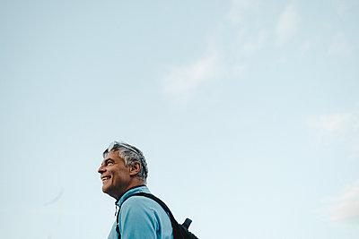Smiling man looking away - p312m2162197 by Stina Gränfors