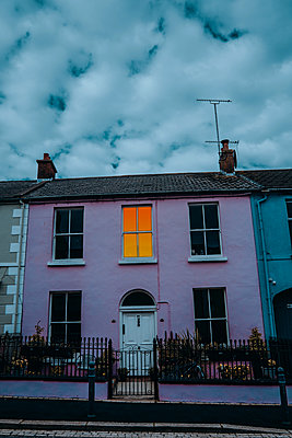 Terraced house with one lighted window, Strangford - p1681m2283614 by Juan Alfonso Solis