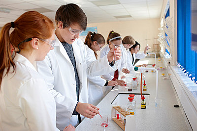 Students working in chemistry lab - p429m757776f by Phil Boorman