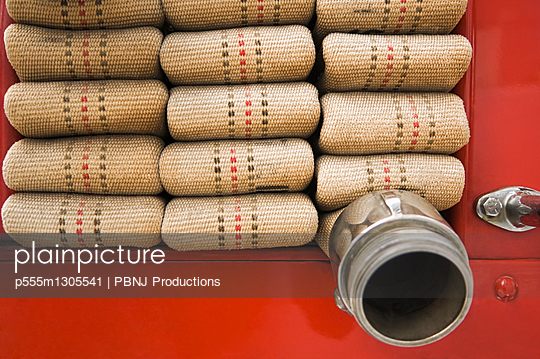 Close up of folded fire hose - p555m1305541 by PBNJ Productions