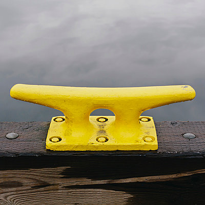A large yellow mooring cleat on the wharf side in Seattle. - p1100m876221f by Paul Edmondson